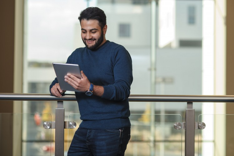 man reading his iPad