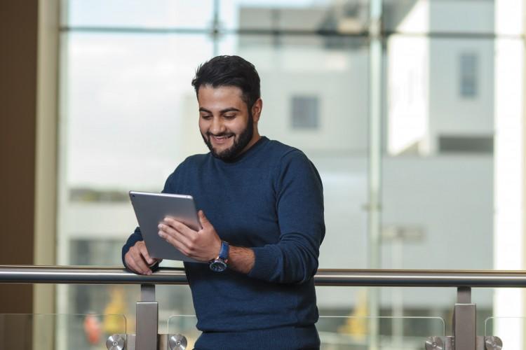 Man looking at an iPad
