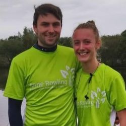 Carla in a green Anne Rowling Clinic running T-shirt with her boyfriend.